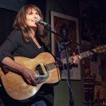 Lisa playing guitar and singing
