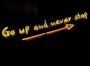 Go up and never stop neon sign