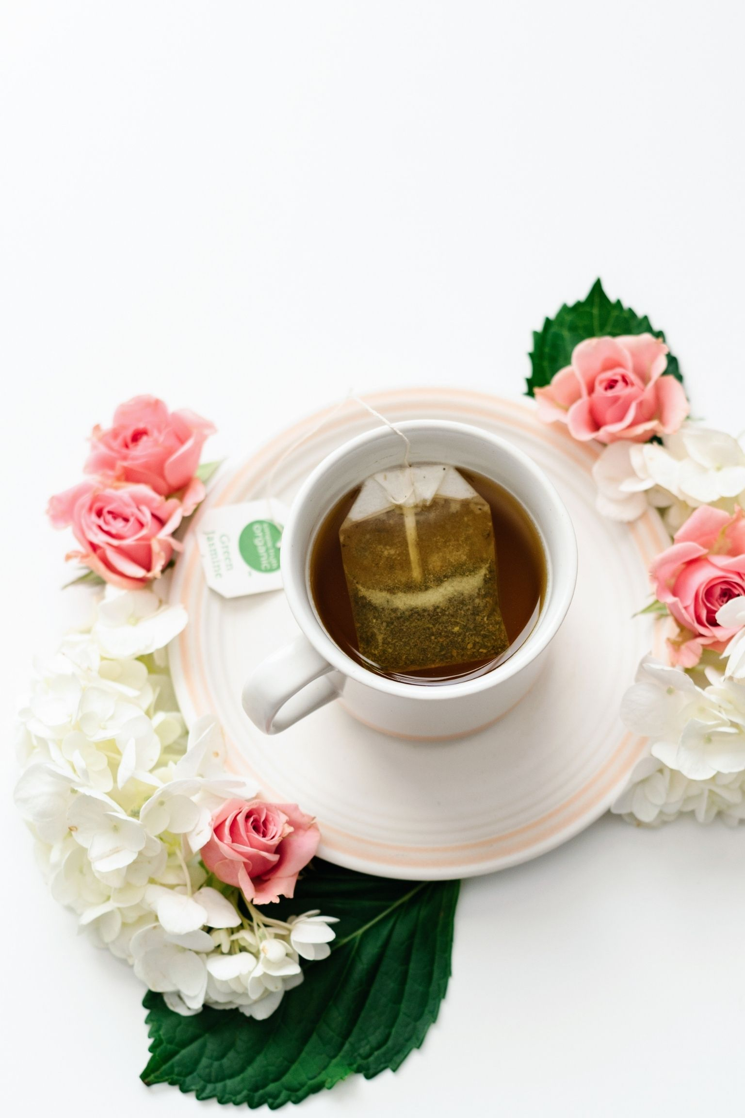 relaxing picture of spring flowers with a cup of tea brewing