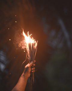 Holding sticks on fire