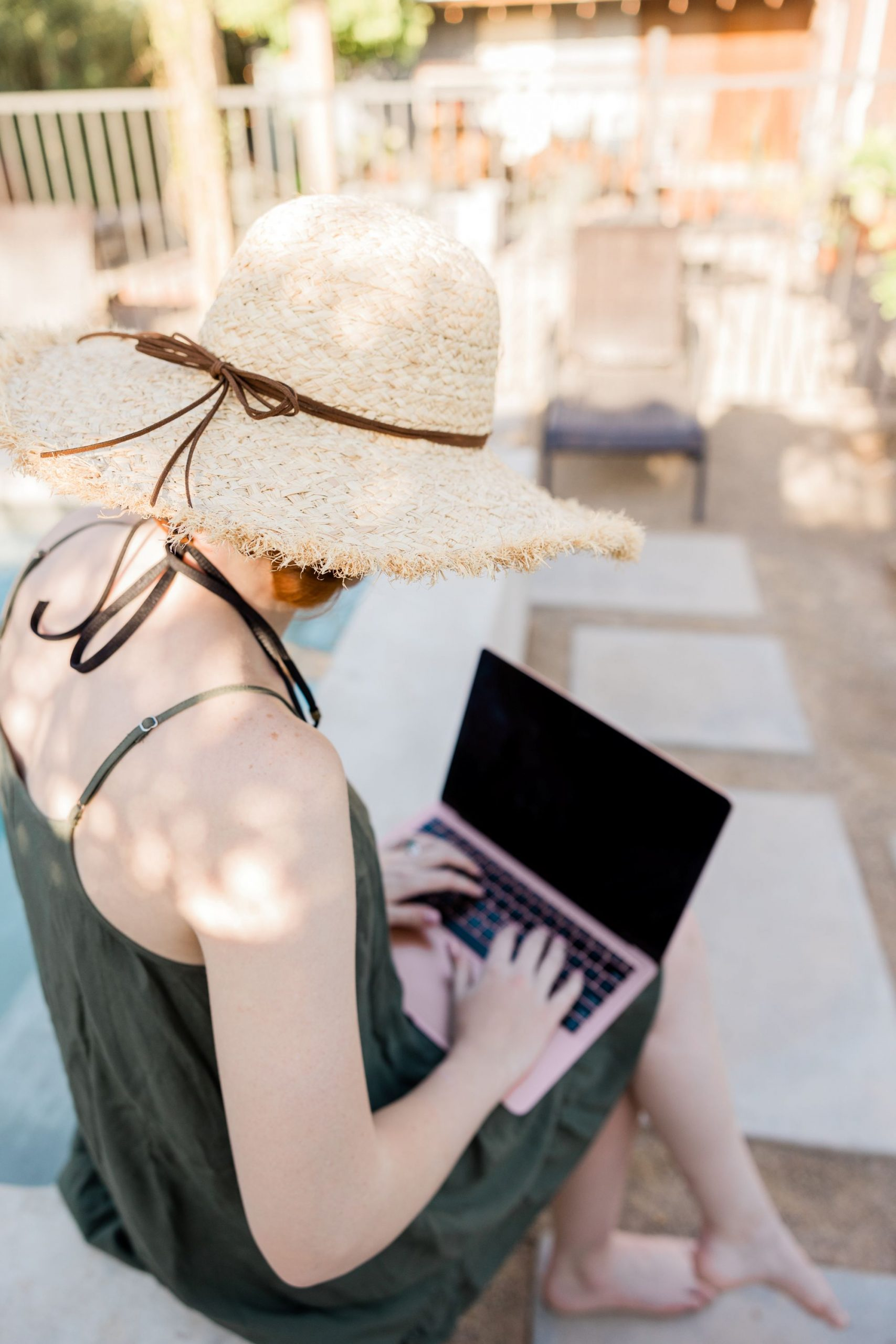 Working poolside with computer