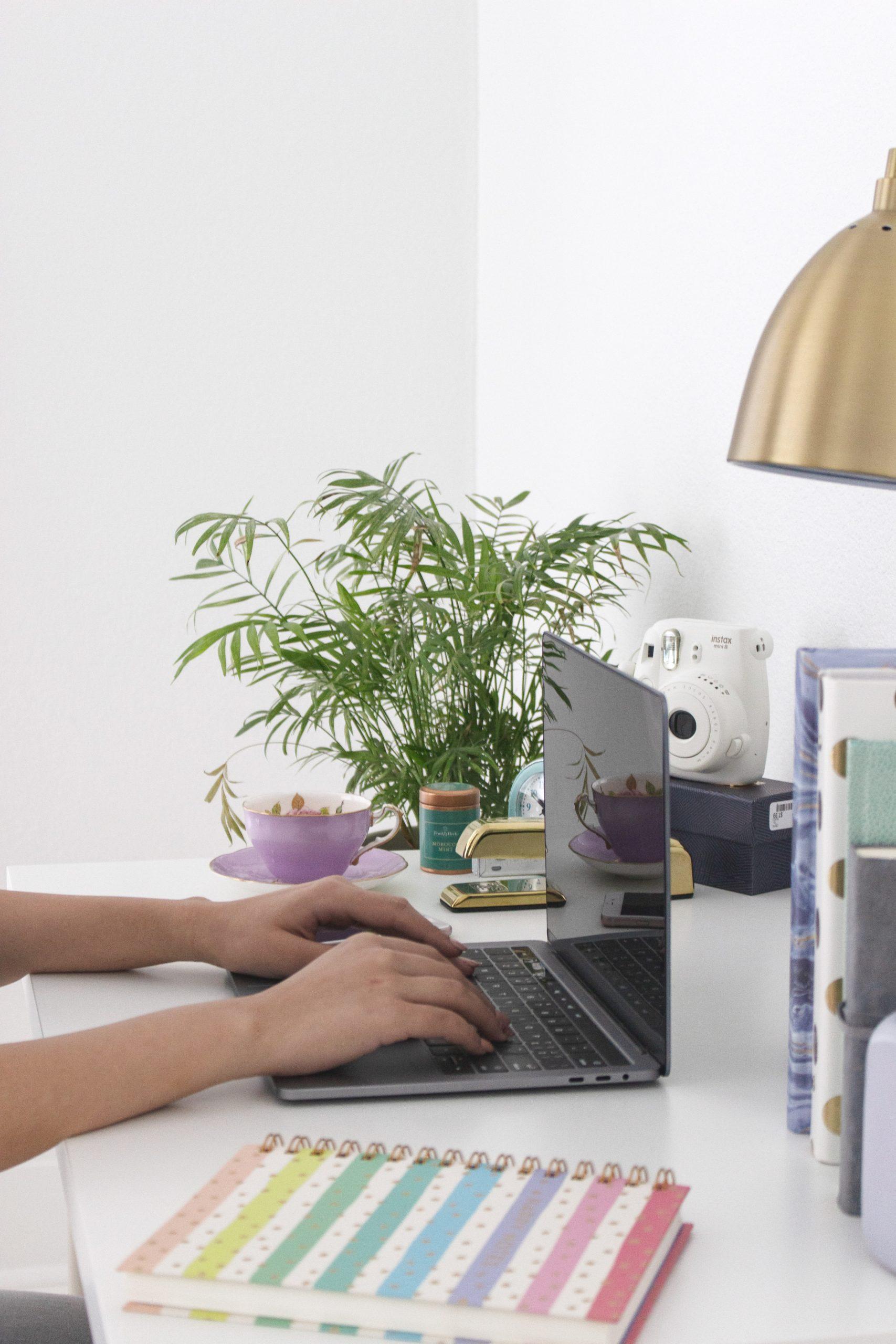 Typing at computer indicating hard work